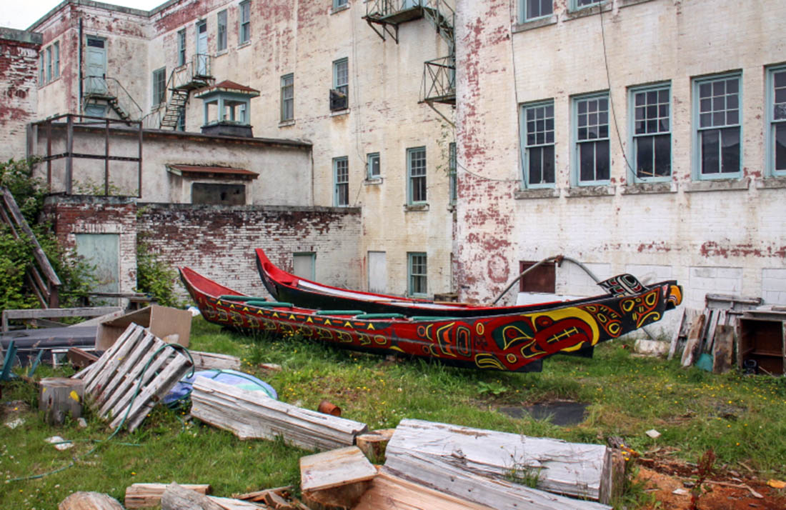 St. Michaels Residential School - Behind with two canoes made by carvers