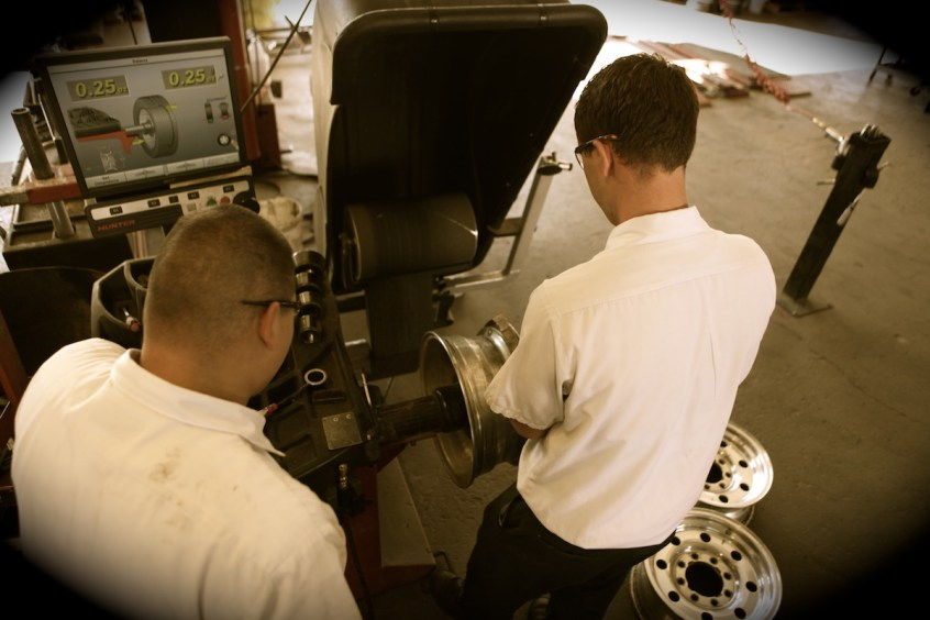 Cleaning the mating surface and checking the trueness & balance of the old, but excellent Alcoa-made Ford wheels.