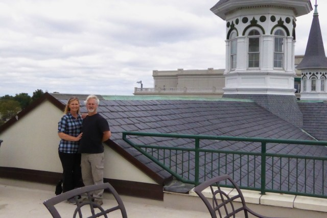 Eddie & Janelle near spires on the roof of Churchill Downs Race Track