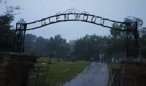 Glenwood Cemetery sign in the rain