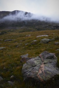 foggy mountain meadow with large rocks