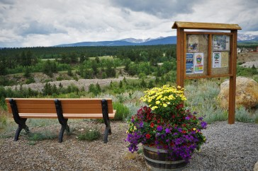 picnic bench and flower pot high in mountain area