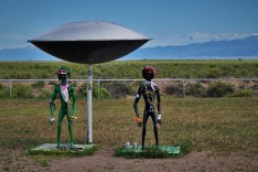 2 alien statues under UFO craft