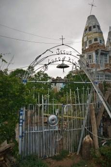 'Jesus Lord of Kings' scrap metal entrance gate