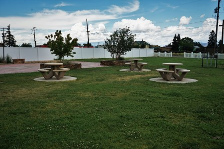 grassy area and picnic tables at small city park