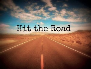 Open Road in the desert with caption 'Hit the Road'