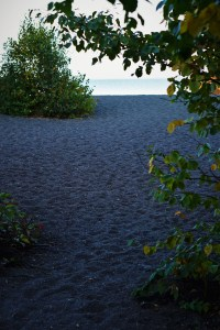 Black sand at a beach on the lake