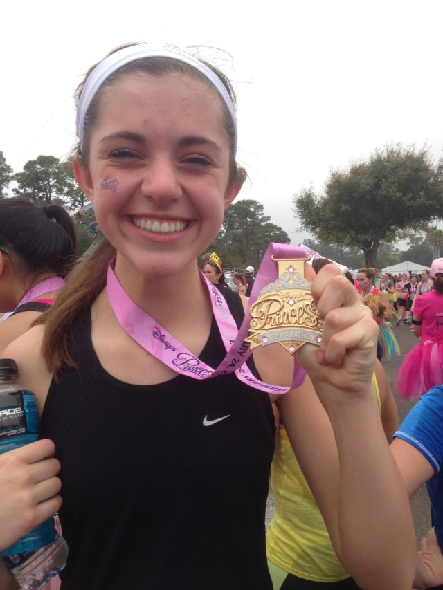 Naomi at Disney Princess Half Marathon with her Medal Bling