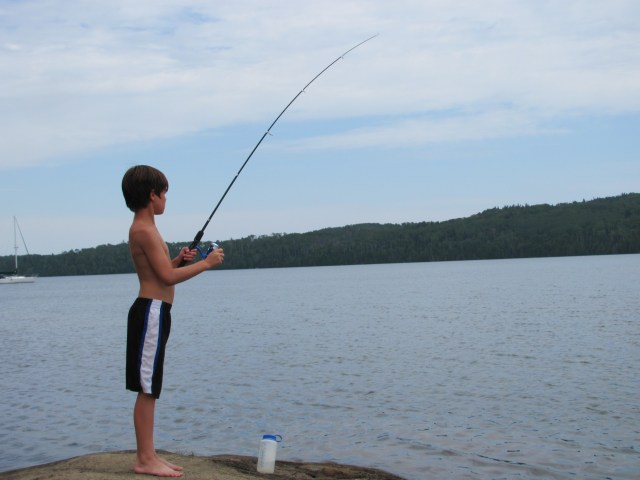 Garrett Fishing in Moskey Basin in Isle Royale National Park