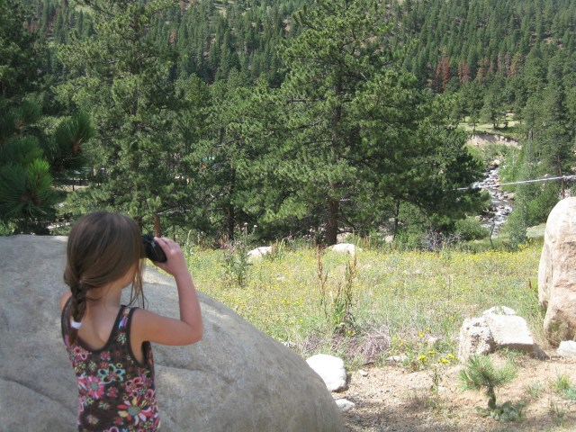 Using Binoculars to Look Around in Rocky Mountain National Park