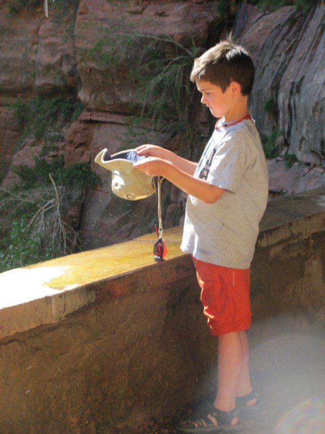 Garrett Collecting Water at Weeping Rock