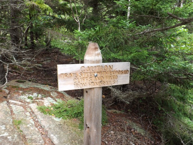 Caution! Climbing ahead on the Beehive Trail in Acadia National Park