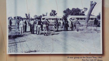 An old picture depicting tour groups stopping at the tree.
