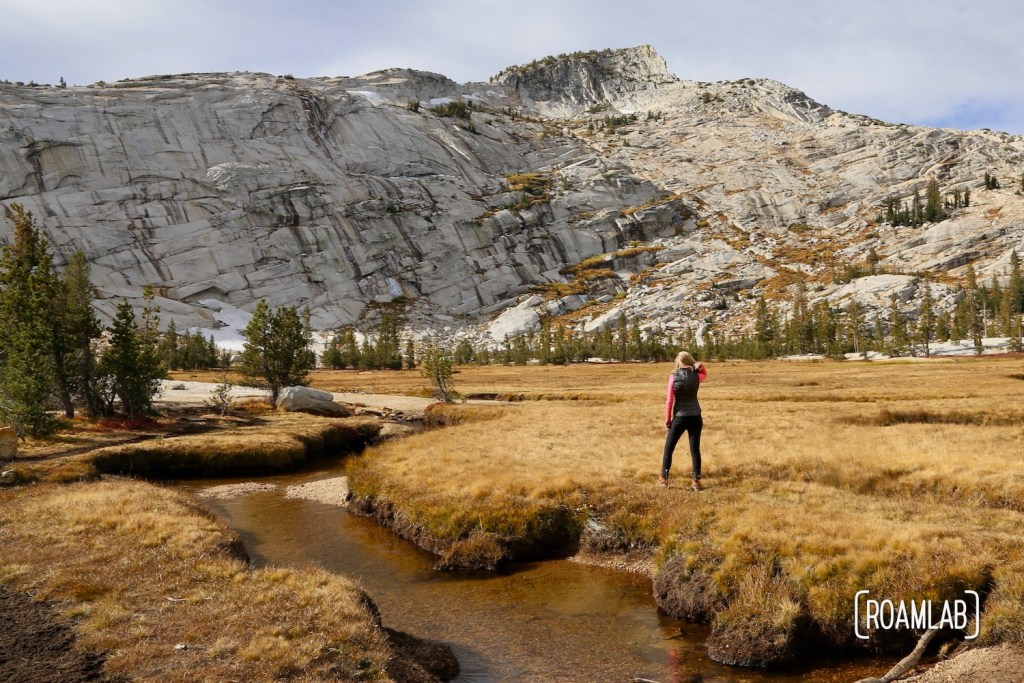 Hiking Cathedral Lakes Trail from Tuolumne Meadows to Lower Cathedral Lake, surrounded by Cathedral, Echo, and Tresidder Peaks in Yosemite National Park.