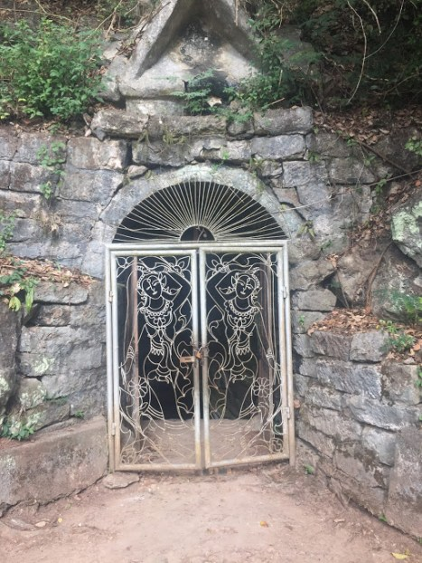 Gated temple cave.