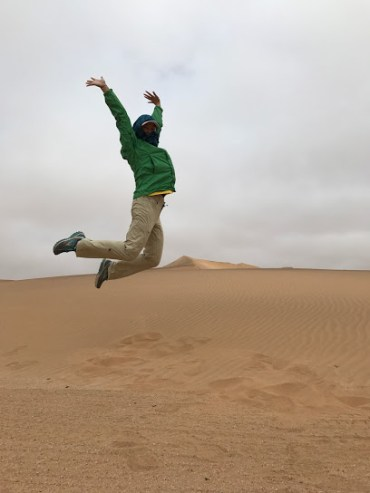 Phi's knee almost knocked over the dune.