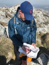 Matt recording our trek in the mountain log!