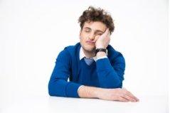 Guy sleeping needs caffeine