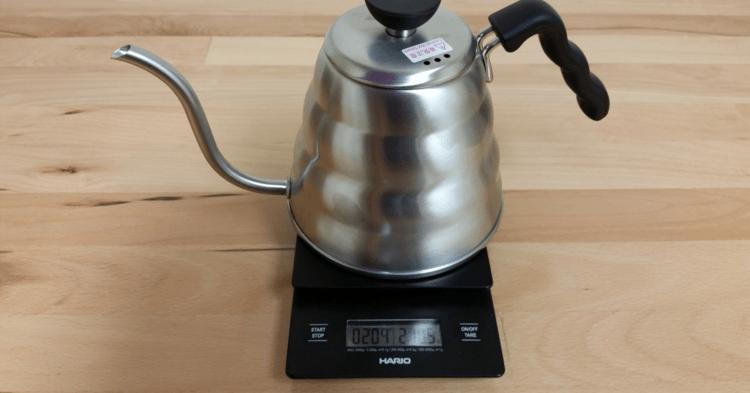 A Hario gooseneck kettle and gram scale