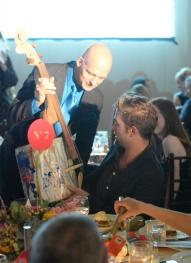 Rob receiving a recycled cello after winning it in the auction