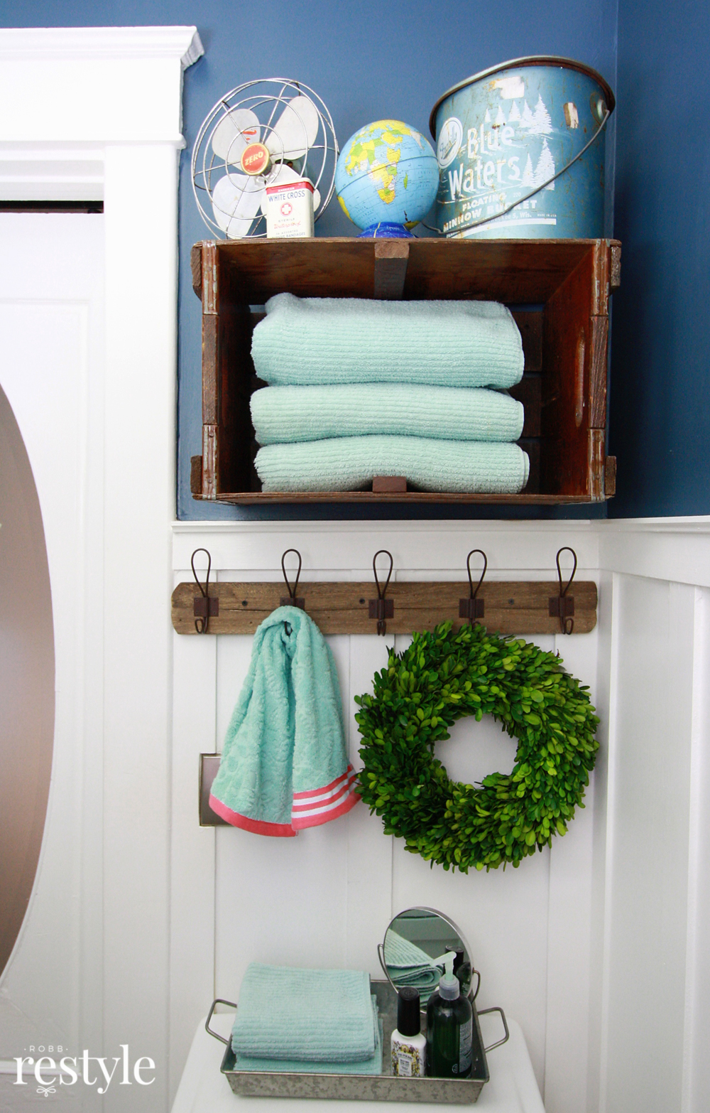 Turn a vintage crate on its side to store bathroom towels.
