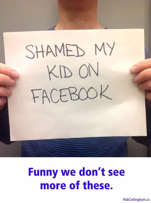 Man holding sign saying 'Shamed My Kid on Facebook'