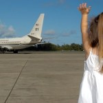 child waving goodbye expat advice on leaving loved ones behind
