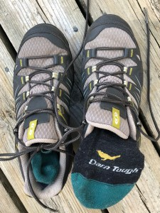 a pair of hiking shoes and socks