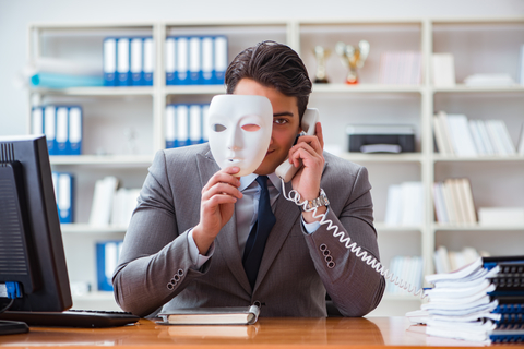 The businessman with mask in office hypocrisy concept