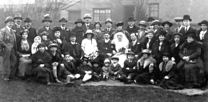 William Henry Hall and Olive Emma Ling's wedding, c. February 1921, Chesterfield, Derbyshire. Olive's mother Mary Ann Bestwick (formerly Ling, formerly Buxton, née Hall) is on the second row, fourth from the right. Courtesy of the National Fairground Archives.