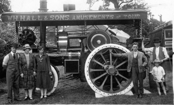 "William Henry Hall & Sons' engine, c. 1920. L-R: Ben Lewis Hobson (son of Ben Hobson and Annie Elizabeth Ling), his wife Sarah Hobson (née Corrigan), possibly Violetta Hall, Henry ""Harry"" Hall, Horace Hall, up identified child. Provenance Keith Henry Hall. Courtesy of the National Fairground Archives."