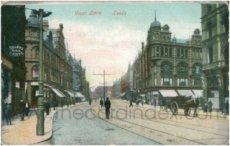 Vicar Lane, Leeds, c. 1910, showing my great-great-grandmother Emma Sillers's mail carts shop on the left (via The Card Index).