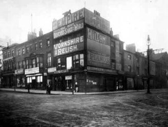 The junction of Duncan Street and Briggate, Leeds, 1902. The sign for my great-great-grandmother Emma Sillers's mailcarts shop can be seen beneath the larger sign for 'Yorkshire Relish' (via Leodis).