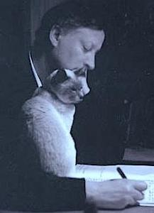 Author Robert Fripp, with cat, Victoria
