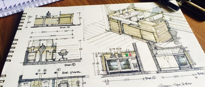 Sketchbook and markers with Furniture design Sketches