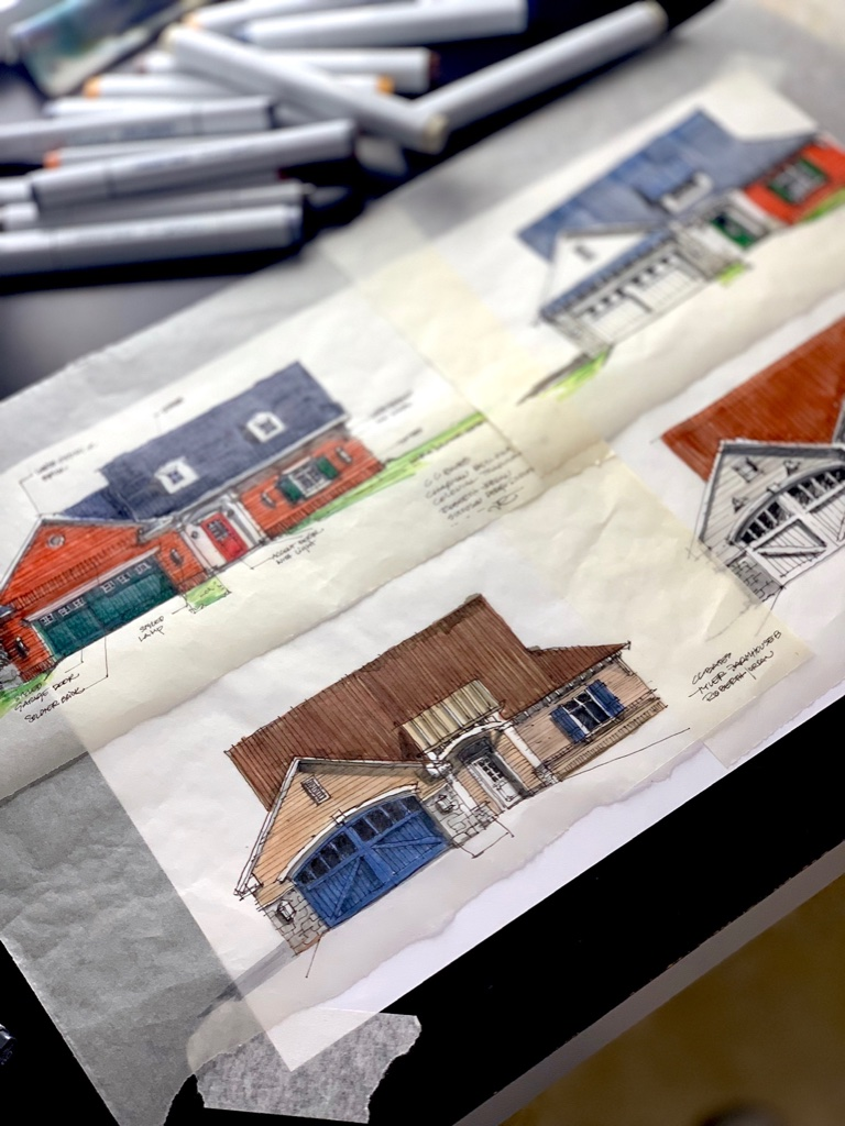 House Sketches over desktop with markers