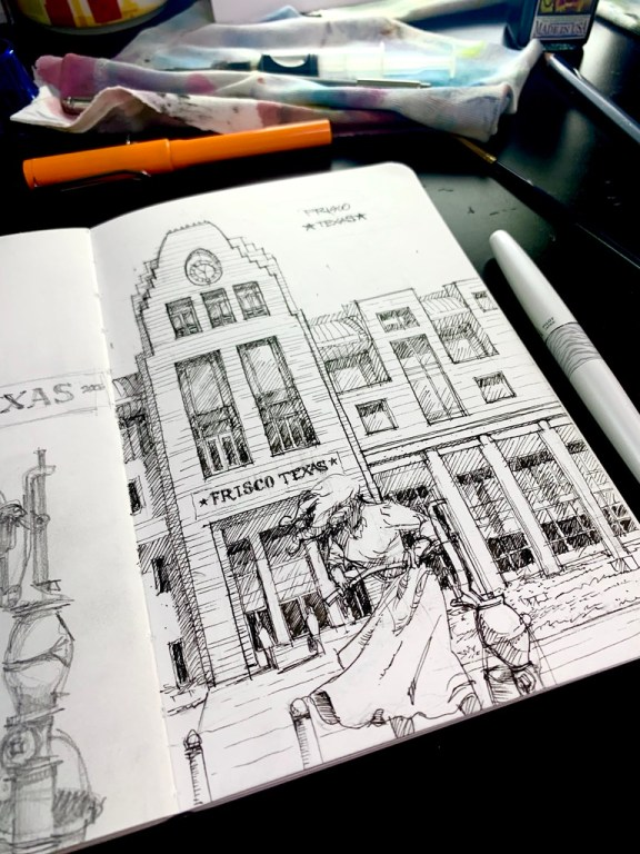 Sketchbook Frisco building and woman statue.