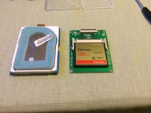 The Compact Flash card installed on the adapter board. It has roughly the same dimensions of the hard drive, only much thinner.