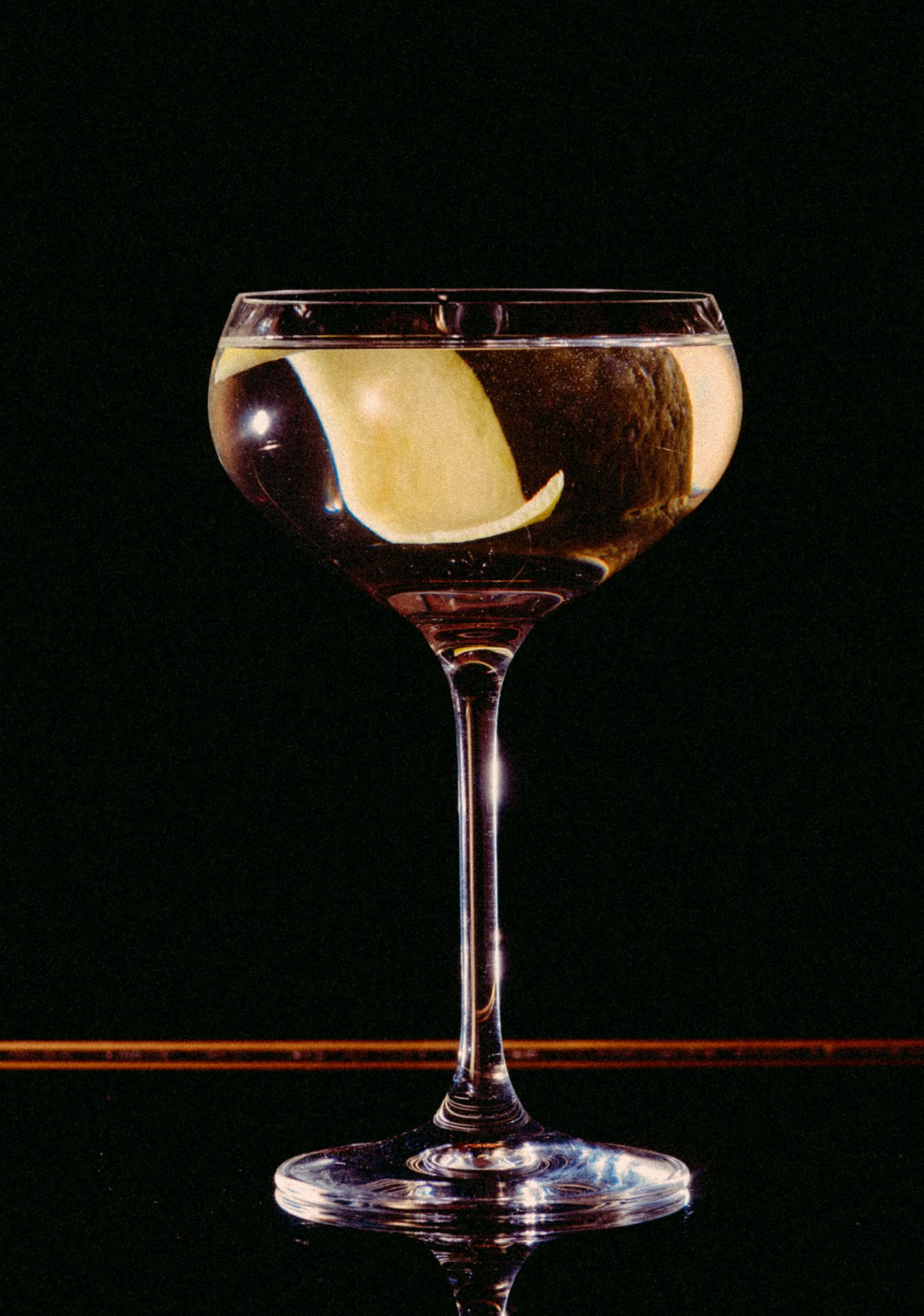 """Recipe: 5cl Plymouth Gin 3cl Russian Standard Vodka 2cl Lillet Blanc Lemon Twist """"More is More"""""""