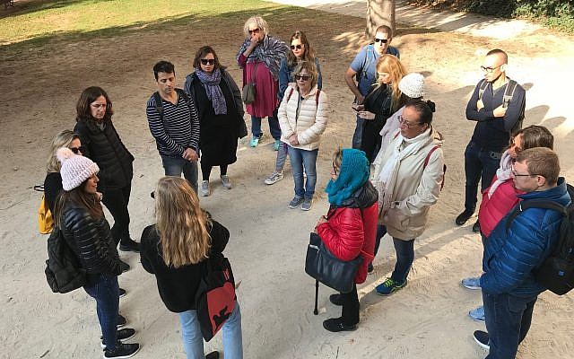 Guide Rotem Gerstel speaks to a tour group in the park. (Robert Sarner/ Times of Israel)