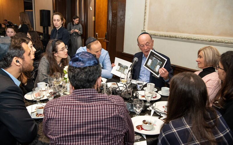 Holocaust survivor Sol Nayman talks about his experiences at the Dinner of Miracles in Toronto, December 15, 2019. (Liora Kogan)