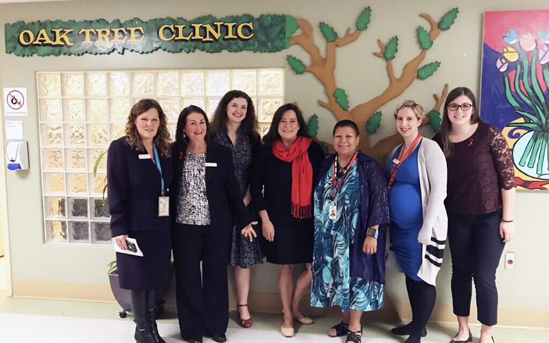 Then-Canadian justice minister Jody Wilson Raybould, center, visits the Oak Tree Clinic just ahead of World AIDS Day in 2017. She is pictured here with Dr. Neora Pick, second from left, and staff. (Courtesy)