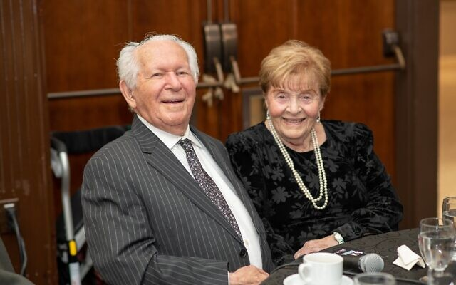 Holocaust survivors Howard and Nancy Kleinberg, who met at Bergen-Belsen and then reunited in Canada two years later and got married, speak at their table at the Dinner of Miracles in Toronto, December 15, 2019.