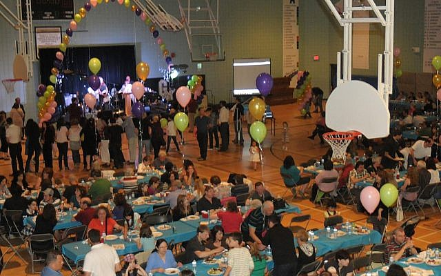Illustrative: The Winnipeg Jewish community holds a party to celebrate the 10th anniversary of a program helping Jews from overseas immigrate to Manitoba, 2013. (Jewish Federation of Winnipeg)