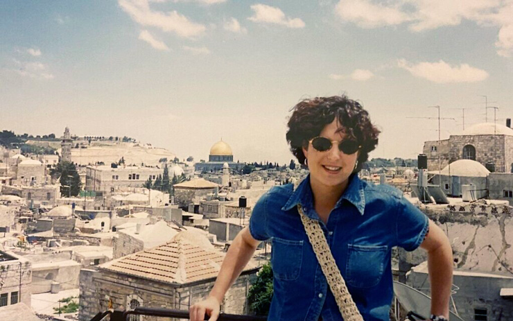 Ya'ara Saks on the wall surrounding Jerusalem's Old City during the first year of her masters degree studies at Hebrew University, in July 1995.