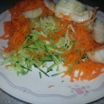 Grated zucchini and carrots, sliced onion, and garlic.