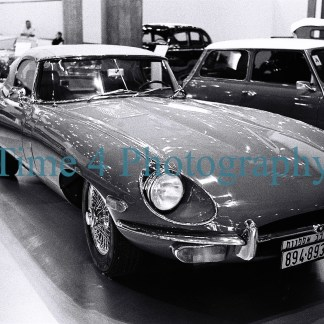 Jaguar XK-E series at a car show, black and white picture