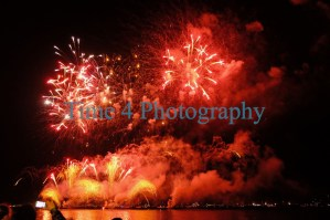 Fireworks over the Tejo river in Lisbon,Portugal, in red and yellow effects