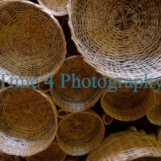 Many wicker baskets hanging from a ceiling in Salvador da Bahia, Brasil.This picture was taken inside a market that sells typical objects from Bahia.