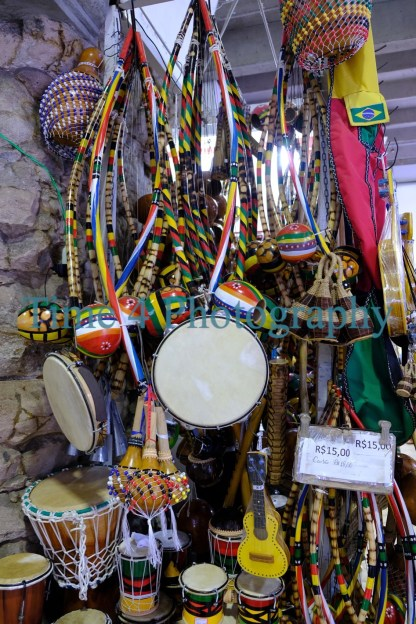 A big choice of typical brazilian musical instruments on display at a popular market in Salvador da Bahia.